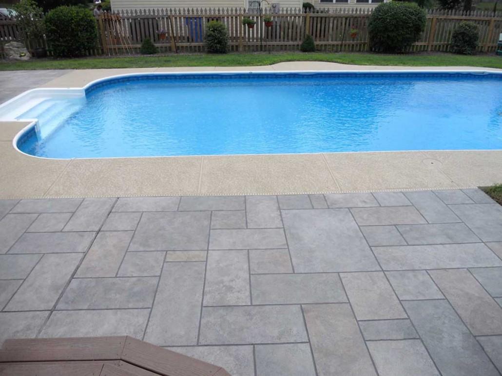 Pool deck gallery aleria custom concrete for Inground pool coping paint
